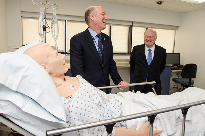 Jeffrey S. Akman, dean of the School of Medicine and Health Sciences and vice president for health affairs, tours the new CLASS Center with George Washington President Steven Knapp.