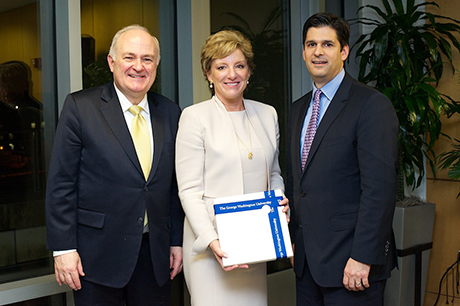GW President Steven Knapp, Avon CEO Sheri McCoy and GW Interim Dean for the School of Business Christopher Kayes.
