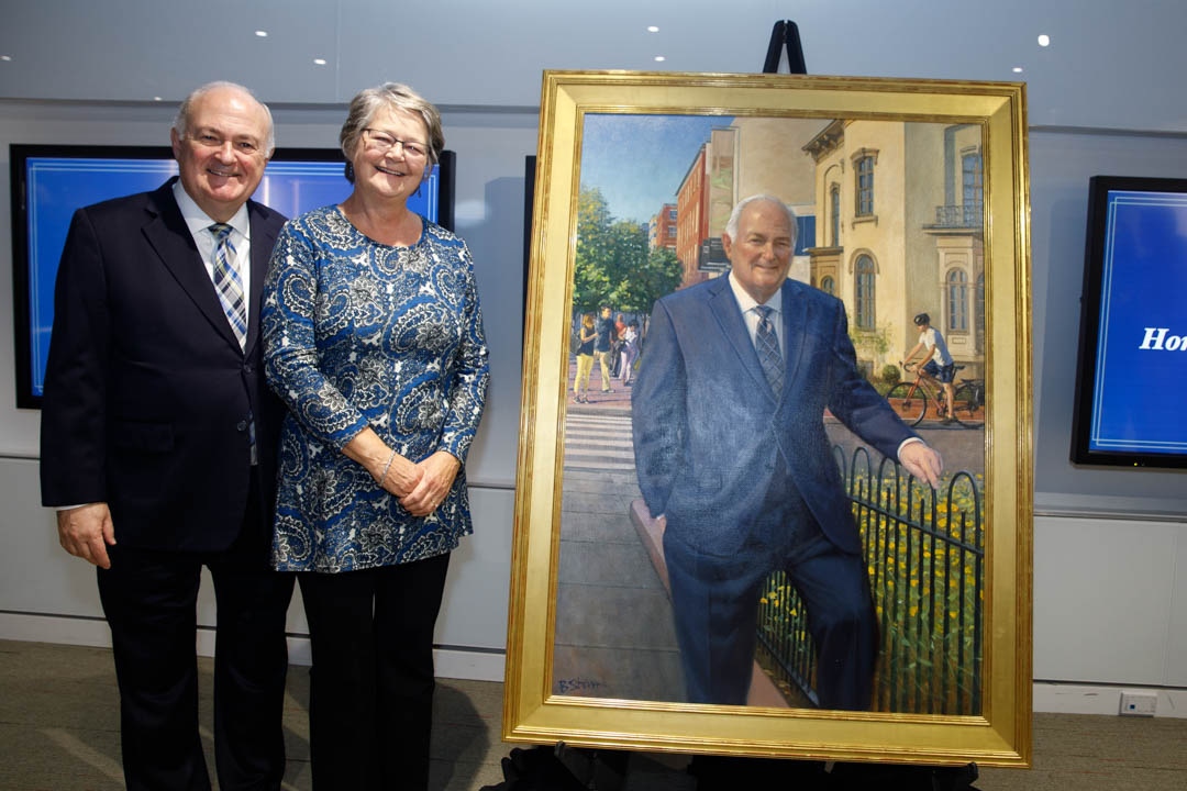 image of Steven Knapp and Diane Robinson Knapp with portrait.