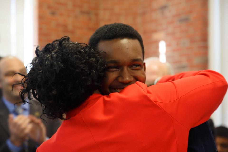 Adonte Yearwood receives a hug from his mother