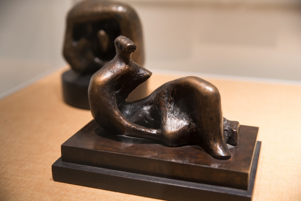 """Henry Moore""""Icons of British Sculpture"""" features Henry Moore's small statues, including """"Draped Reclining Figure: Knee."""""""