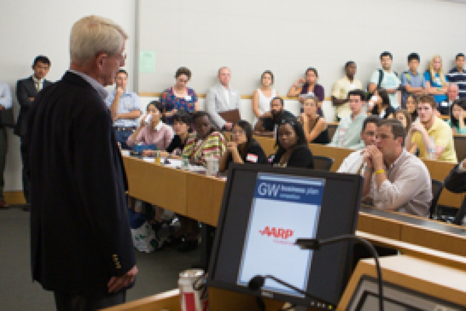 Founding Director John Rollins addresses student, faculty and alumni entrepreneurs at the 2014 GW Business Plan Competition kick