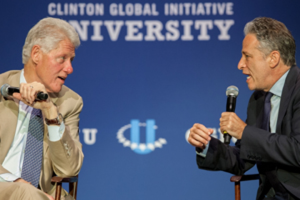 Jon Stewart and Bill Clinton at the Clinton Global Initiative University speaking on stage