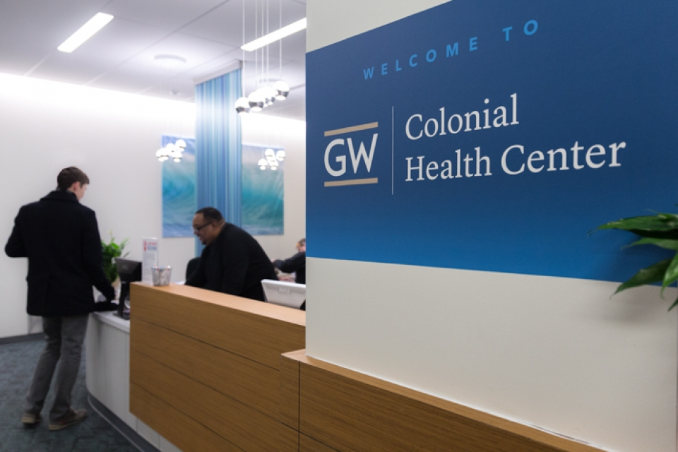 Colonial Health Center lobby with a person checking in at front desk