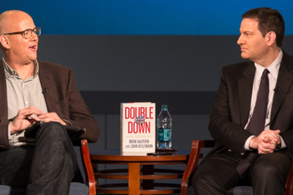 John Heilemann and ark Halperin sit on stage to discuss Double Down