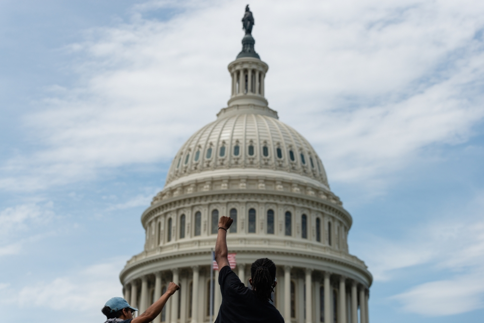 A protestor in front of the U.S. Capitol. (Eric Lee)