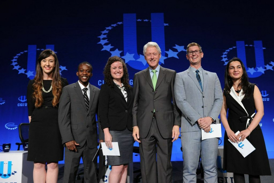 Mariam Adil (far right) onstage at conference with President Bill Clinton and other commitment makers. (Photo courtesy CGI U)