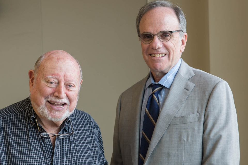 CASJE founder Lee Shulman with GSEHD Dean Michael Feuer. (Logan Werlinger/GW Today)