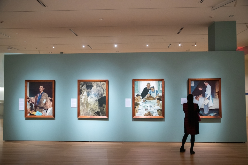 "A visitor to the GW University Museum and The Textile Museum views Norman Rockwell's ""Four Freedoms"" paintings. (Harrison Jones/"