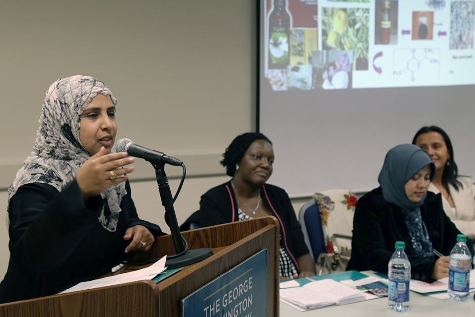 Ghanya Naji Mohammed Al-Naqeb speaks at the Marvin Center, joined by (from left) Etheldreda Nakimuli-Mpungu