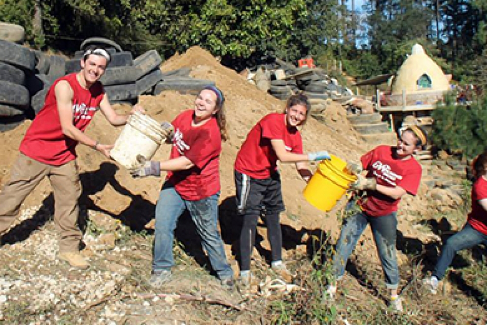 GW students passing buckets of water while on an alternative break trip in Guatemala