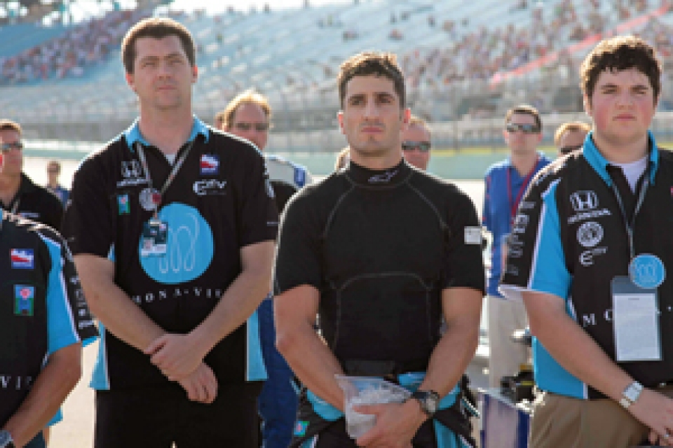 Hugo Scheckter with teammates on race track