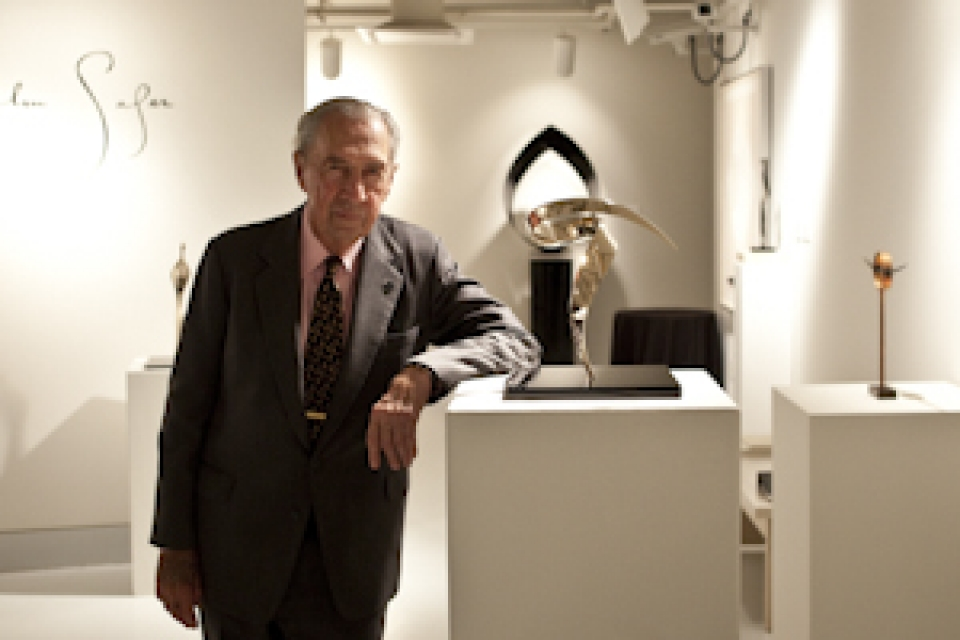 John Safer posing with one of his pieces at the Luther Brady Gallery