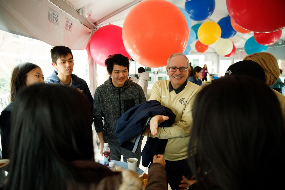 President Thomas LeBlanc with students