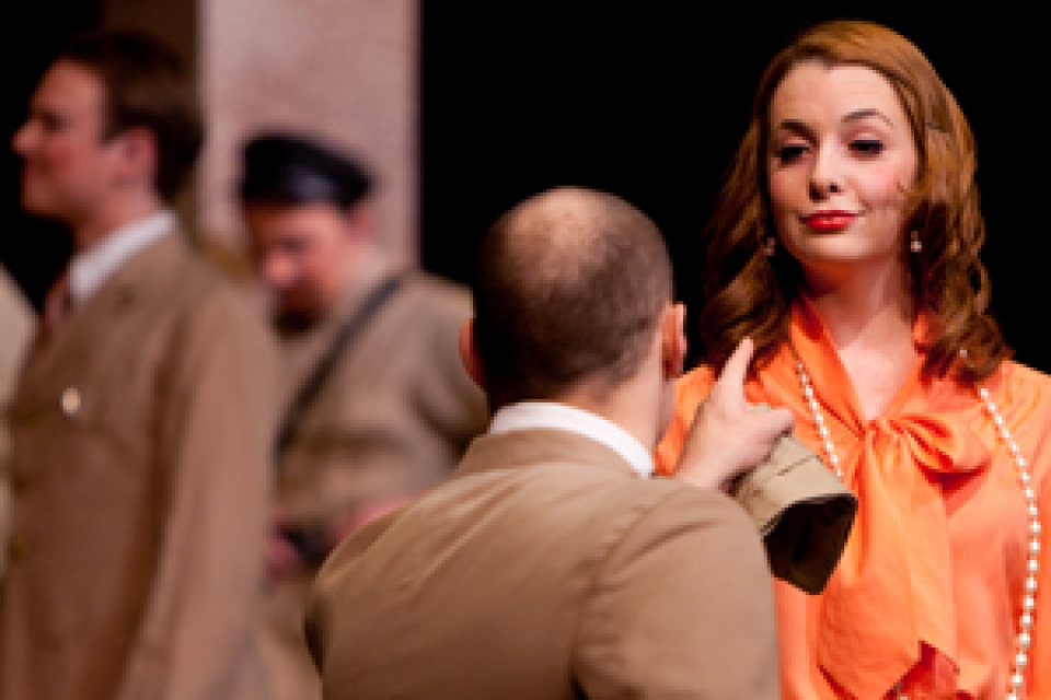 two students acting in Much Ado About Nothing, with a male looking at a female pointing his finger