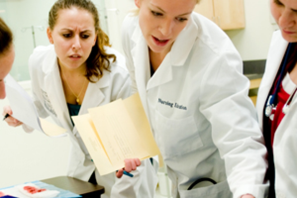 nursing students in lab coats