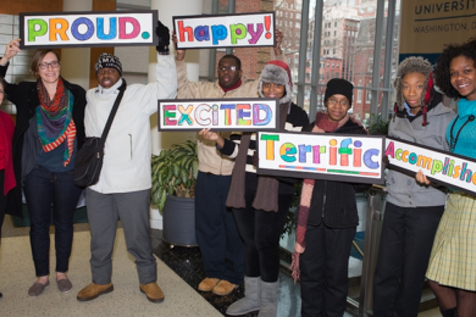 "Project Search members hold up signs, ""proud,"" ""happy,"" ""excited,"" ""terrific,"" and ""accomplished"""