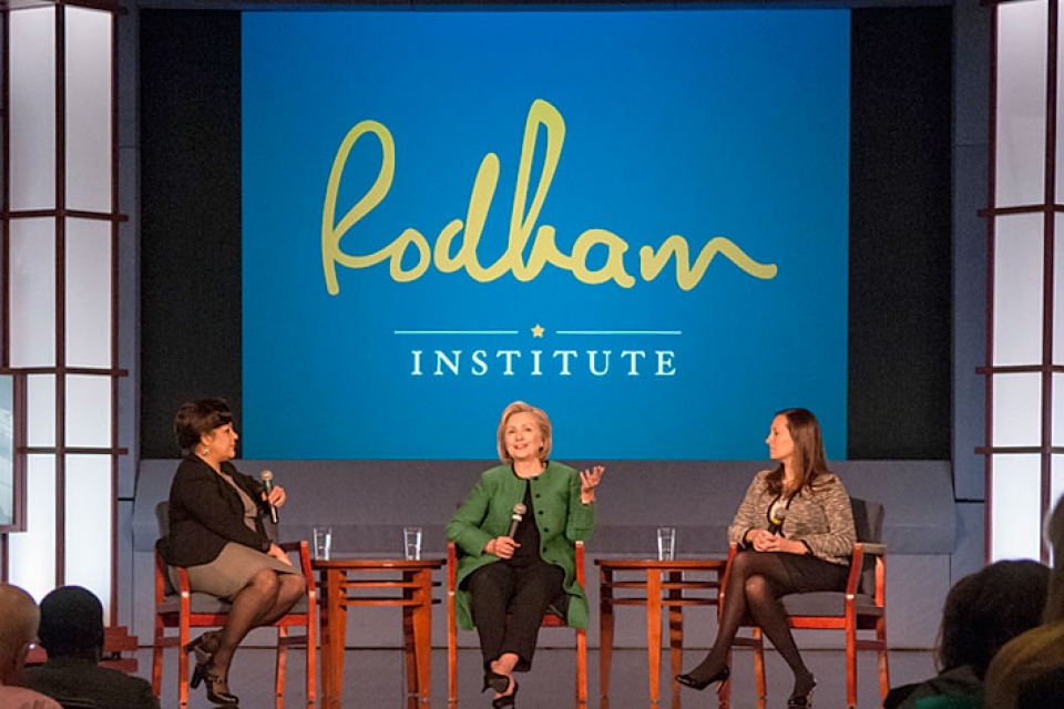 Hillary Rodham Clinton, center, and other attendees to the summit discussed methods to effectively promote health.