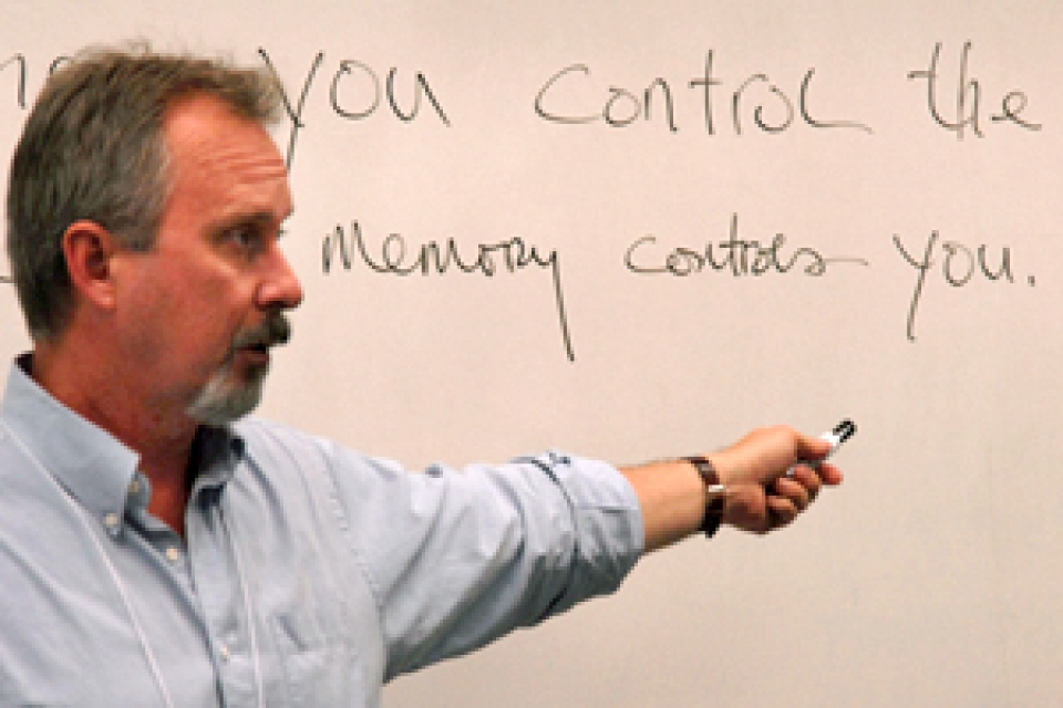 Ron Capps teaches at white board