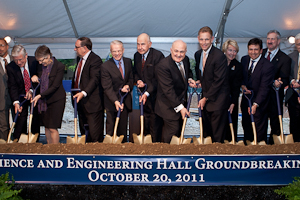 groundbreaking of SEH with members of the university community holding shovels to commemorate the moment