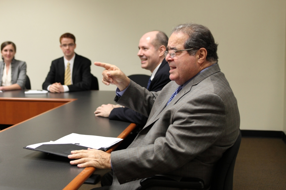 Antonin Scalia, foreground, with Bradford Clark at a symposium at GW Law in 2011. (Photo courtesy GW Law)
