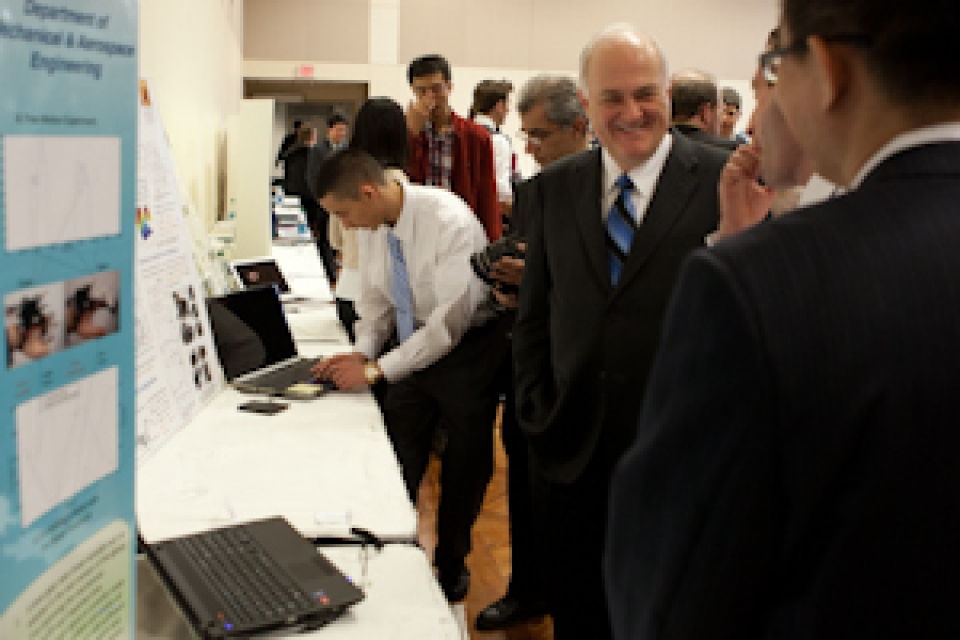 university community observes research presentation boards at Research and Development Showcase