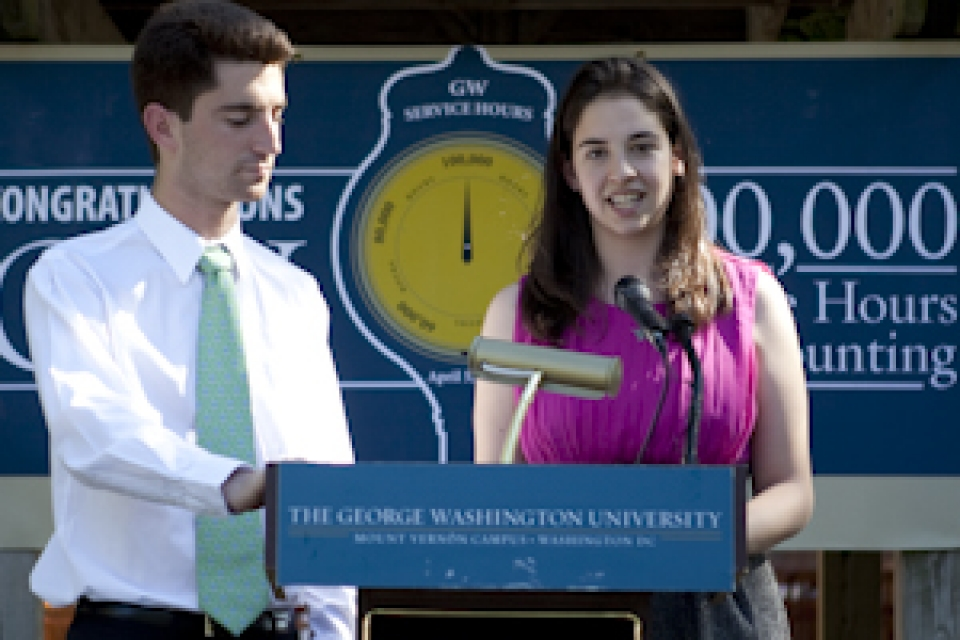students speaking at podium for service challenge