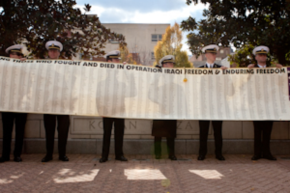 GW veterans hold banner featuring 2,000 names