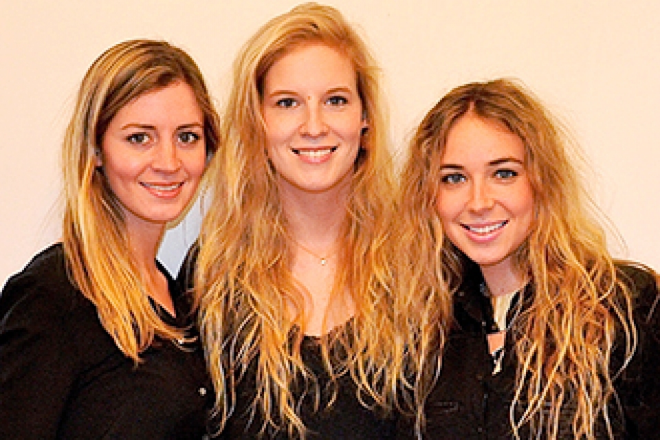 ZOOM Interiors Co-founders smile as group of three females