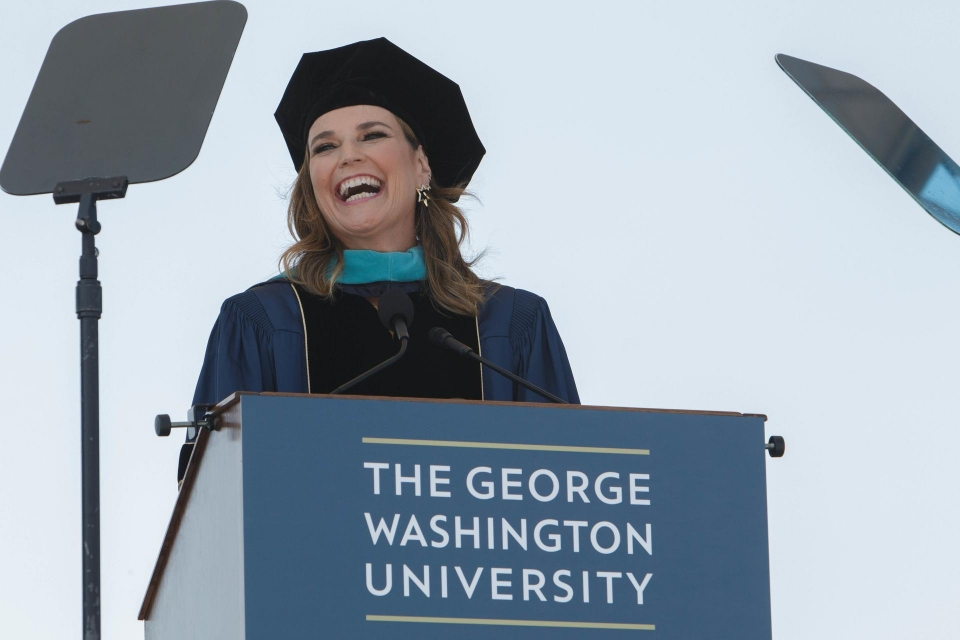 Savannah Guthrie smiling at podium