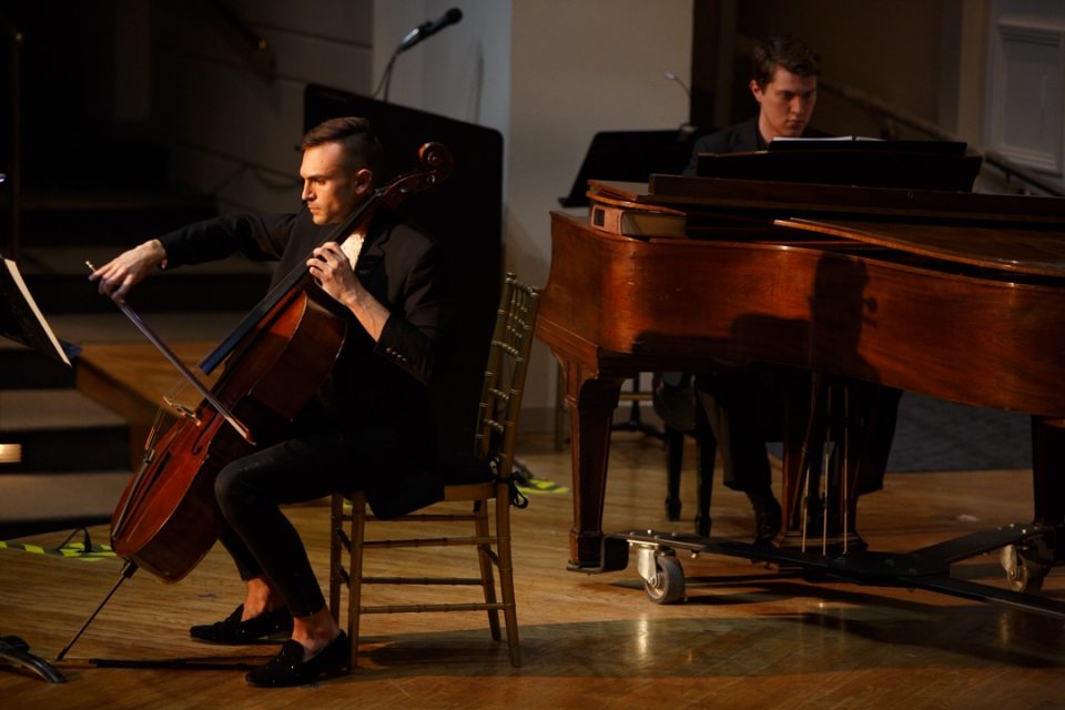 student playing cello and piano
