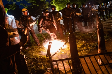 Image of police with a firework-like object