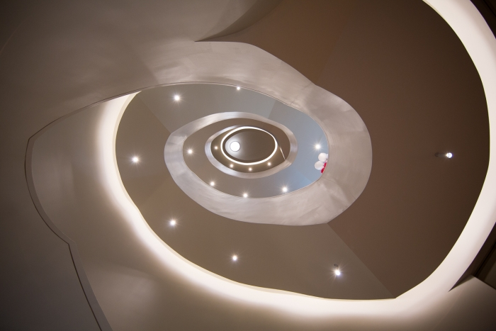 A stunning elliptical staircase extends down the museum's floors.