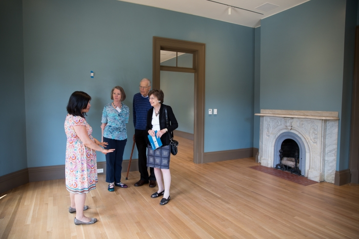 Visitors tour the renovated, 160-year-old Woodhull House.