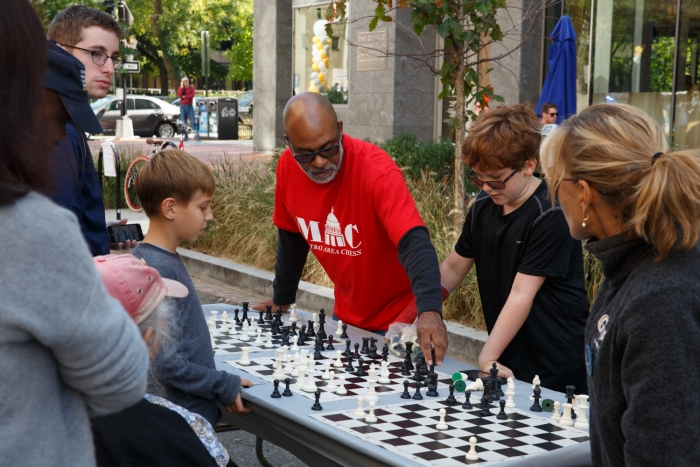 Neighbors interacted with community organizations like Metro Area Chess at the Block Party.