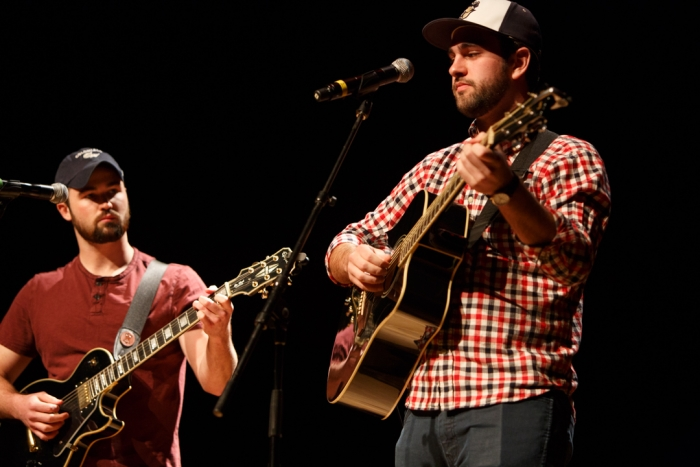 Dan Fanelli, BA '16, and senior Sam Evans opened the show playing guitar