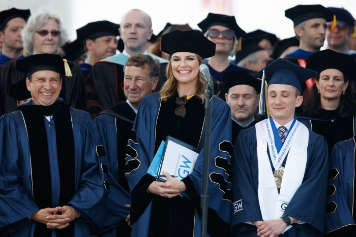 Savannah Guthrie with group of university members smiling on stage