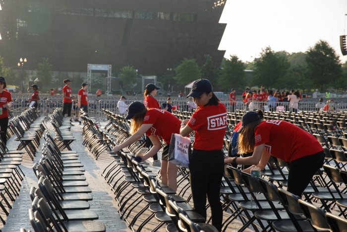 staff volunteers cleaning up chairs