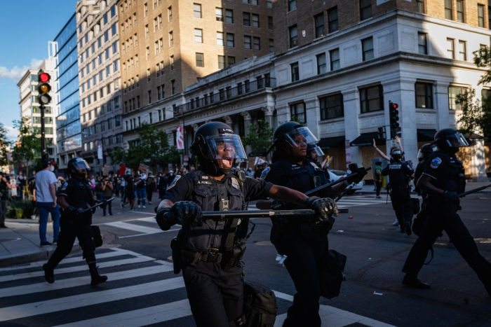Image of police with batons