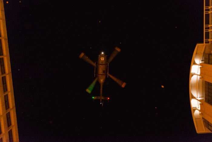 Image of a descending helicopter from beneath