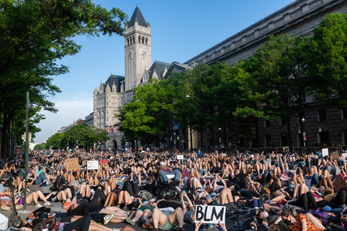 Image of protesters lying down near Trump Hotel