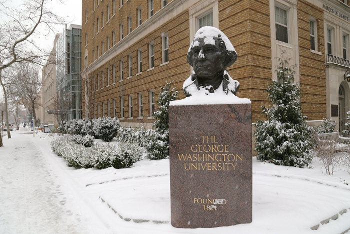 A bust of George Washington stands sentinel outside of Marquis De Lafayette Hall on the Foggy Bottom campus during the first sno