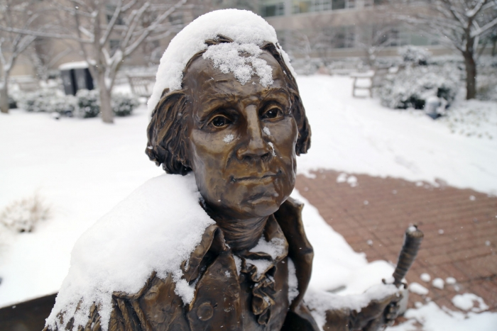 """The recently installed """"George Washington Bench,"""" featuring the first president himself, sports a covering of powdery snow. (Rob"""