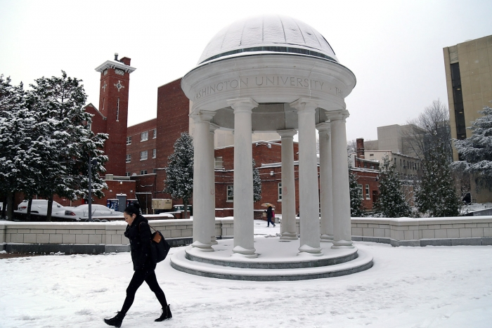 The first snowfall of the year also brought plunging temperatures, which inspired pedestrians to walk briskly by the Tempietto i