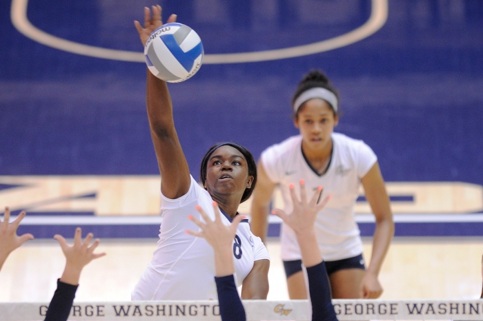 GW sophomore Chidima Osuchukwu soars for a kill shot during a match against rival Rhode Island during a recent match at the Smit