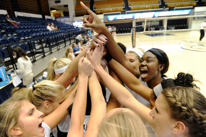The George Washington University volleyball team gathers around as they prepare for a match against Atlantic 10 foe Rhode Island