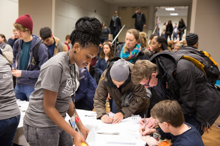 Volunteers sign in for the Day of Service