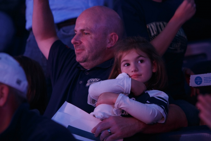 little girl looks on at Colonial MAdness