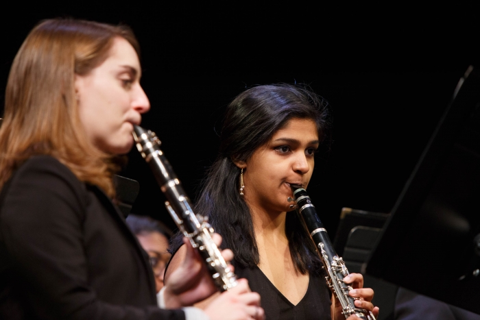 two students playing clarinets