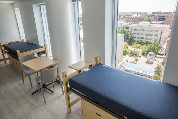 two lofted beds against window with view of Washington Monument